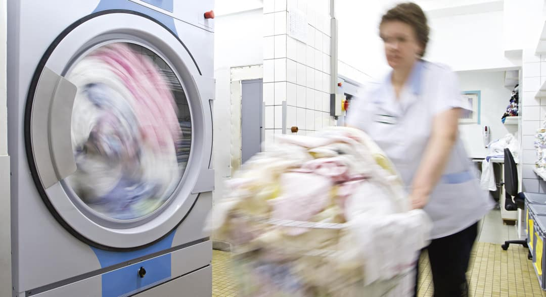 person doing laundry