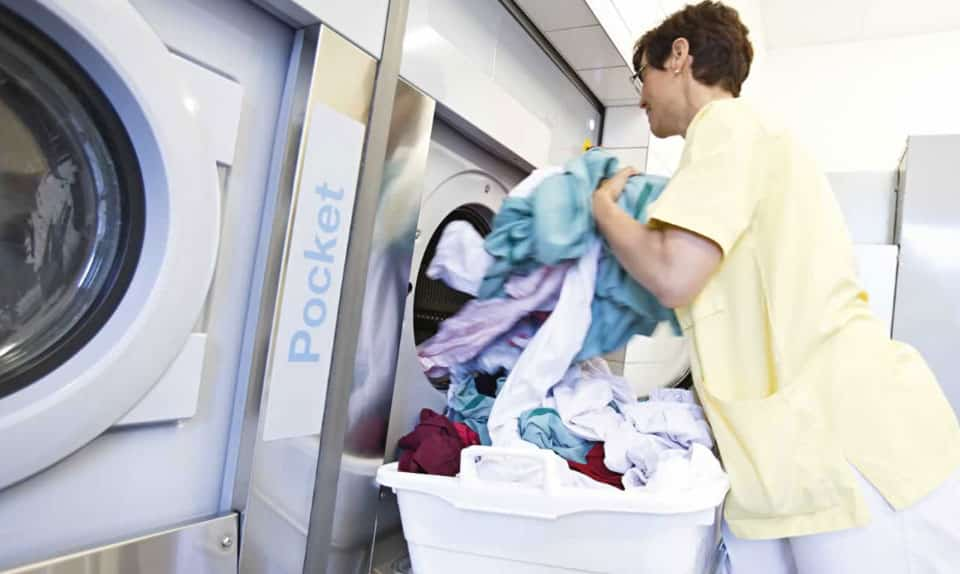 removing clothes from laundry machine